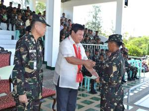 Pvt Rossel  S Tawagon who graduated number one and Physical Proficiency Awardee of her Class receives a certificate of appreciation from Hon. Denis B. Habawel, the Provincial Governor of Ifugao during the Graduation Ceremony of CSC Class 347-13 held at the Division Grandstand on 14 May 2014. Assisting him is BGen Ricardo B Jalad AFP, the Assistant Division Commander, 5ID. ( Photo by: SSg Romulo C Ignacio)