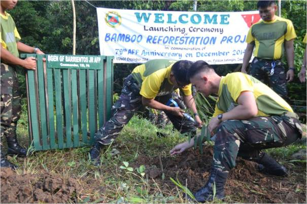 COL MAGUNDAYAO JR, Acting Chief of Staff and MAJ SIA-ED, Deputy G3plant a Giant Bamboo seedling during the launching  of the  Bamboo Reforestation Project ICOW 79th AFP Anniversary to the participants at the vicinity of Jungle Base , Hqs, 1ID, PA