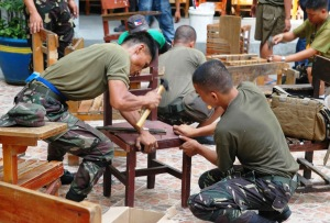 Personnel from the Army's 302nd Brigade and CAFGUs providing manpower assistance in repairing school facilities in various elementary schools in Negros Oriental. Said activity was part of the DepEd's Brigada Eskwela program in preparation for the opening of classes for School Year 2015-2016.